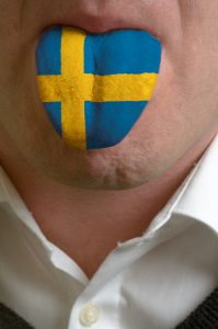 3701935-man-tongue-painted-in-sweden-flag-symbolizing-to-knowledge-to-speak-foreign-language